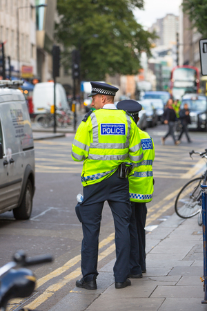 britain: LONDON, UK - SEPTEMBER 17, 2015: Policemen officers at the Londons street