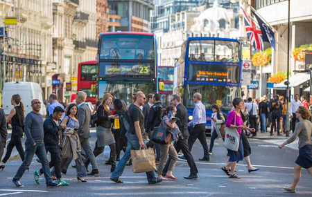 LONDON, UK - SEPTEMBER 10, 2015: City of London, people crossing the road Editorial