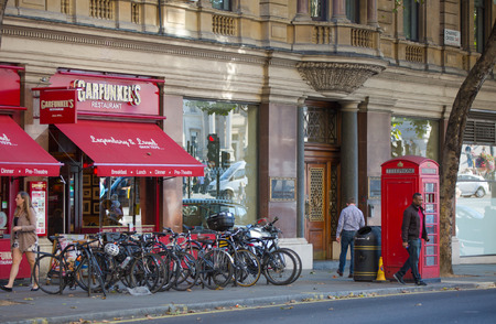parked bikes: LONDON, UK - SEPTEMBER 10, 2015: Cafe at the Trafalgar street with parked bikes on the side Editorial