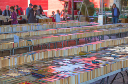 southbank: LONDON, UK - SEPTEMBER 10, 2015: People looking for book bargain in The Southbank Centres Book Market