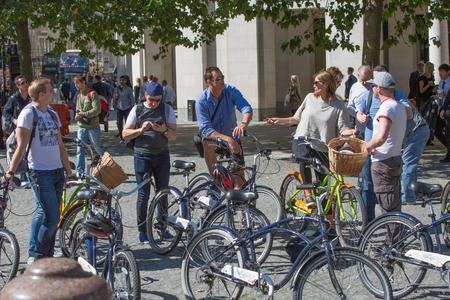 bike parking: LONDON, UK - SEPTEMBER 10, 2015: Tourists at bike parking line
