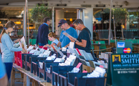 secret place: LONDON, UK - SEPTEMBER 10, 2015: People looking for book bargain in The Southbank Centres Book Market
