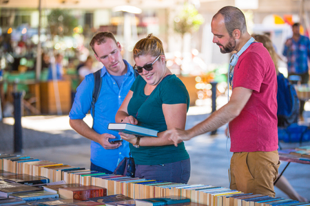 bargain for: LONDON, UK - SEPTEMBER 10, 2015: People looking for book bargain in The Southbank Centres Book Market