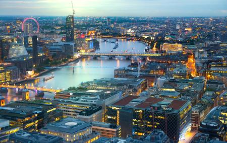 sunset city: London at sunset.  River Thames, bridges and night lights City of London Stock Photo