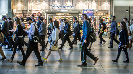 tube station: LONDON UK - SEPTEMBER 10, 2015 - Lots of office workers walking pass the Canary Wharf tube station