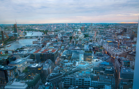 panoramic view: London at sunset.  River Thames, bridges and night lights City of London Stock Photo