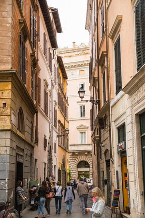 mediterranian houses: ROME, ITALY - APRIL 8, 2016: Narrow street in the centre of Rome with tourists walking pass Editorial