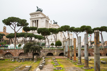 long feet: ROME, ITALY - APRIL 8, 2016: Emperor Trajan Forum 106–112 AD, measuring 300 metres (980 feet) long and 185 metres (607 feet) wide Editorial
