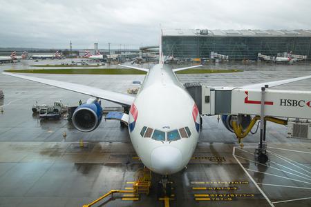 airways: LONDON, UK - APRIL 7, 2016: British Airways plane in the Heathrow airport terminal 5 getting ready to depart