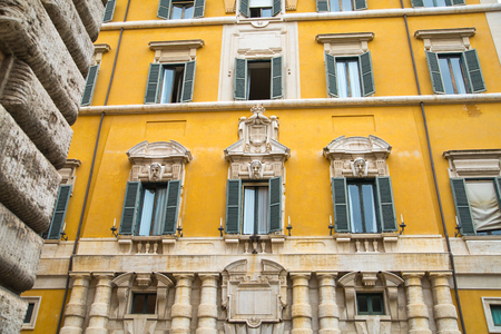 mediterranian houses: ROME, ITALY - APRIL 8, 2016: House facade in the centre of Rome, Mediterranean architecture