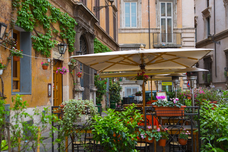 mediterranian houses: ROME, ITALY - APRIL 8, 2016: Street in the centre of Rome with restaurant view Editorial