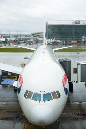 to depart: LONDON, UK - APRIL 7, 2016: British Airways plane in the Heathrow airport terminal 5 getting ready to depart