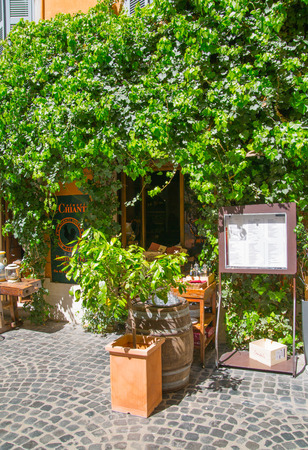 mediterranian houses: ROME, ITALY - APRIL 8, 2016:  Menu and Restaurant  entrance at the Romes street