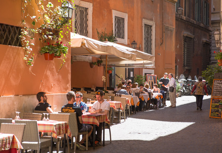 mediterranian houses: ROME, ITALY - APRIL 8, 2016:  Restaurant and people waiting to be served at the Romes street Editorial