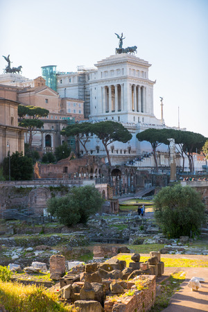 altar of fatherland: ROME, ITALY - APRIL 8, 2016: Romans forum with ruins of important ancient government buildings started 7th century BC and  Altar of the Fatherland (Altare della Patria) at the background