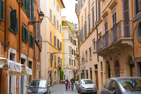 mediterranian houses: ROME, ITALY - APRIL 8, 2016: Street in the centre of Rome with people walking via the street