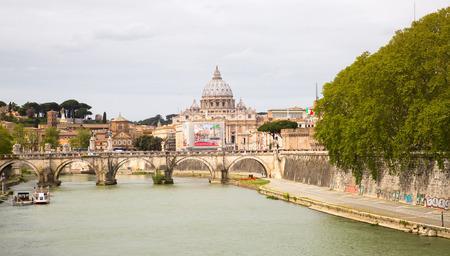 beatification: ROME, ITALY - APRIL 8, 2016:  St Peters basilica in Vatican, river Tiber view and Roman bridge