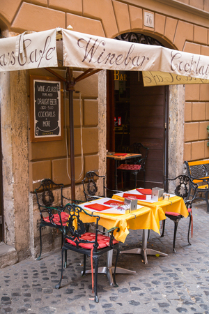 ROME, ITALY - APRIL 8, 2016: Restaurant entrance and table ready to take a costumers at the Romes street Editorial