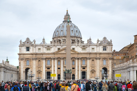 peter's: ROME, ITALY - APRIL 8, 2016:  St Peters basilica in Vatican, Saint Peters Square view with lots of people Editorial