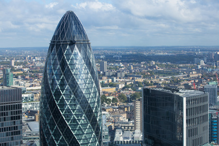 gherkin: LONDON, UK - OCTOBER 14, 2015; Gherkin building Modern office blocks City of London, business and banking aria. Editorial