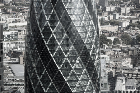 recognised: LONDON, UK - OCTOBER 14, 2015.  Gherkin - iconic symbol of modern London, one of  the widely recognised office block building.