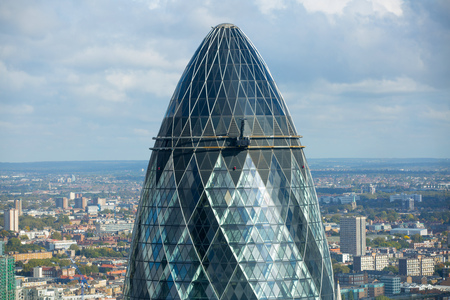 recognised: LONDON, UK - OCTOBER 14, 2015.  Gherkin - iconic symbol of modern London, one of  the widely recognised office block building. View from the 32 floor Editorial