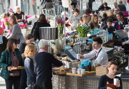 refreshments: LONDON, UK - OCTOBER 14, 2015 - People by the Sky Garden bar ordering coffee, snacks and refreshments Editorial