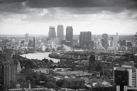wharf: LONDON, UK - OCTOBER 14, 2015. Canary Wharf and River Thames