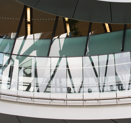 go inside: LONDON, UK - SEPTEMBER 19, 2016: Famous spiral staircases of London City Hall with walking people. Modern architectural structure