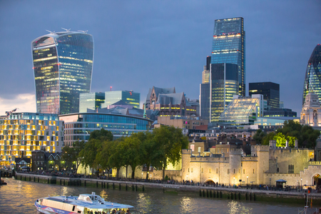 night dusk: LONDON, UK - SEPTEMBER 19, 2015: City of London at dusk and first night lights. View includes Gherkin and other buildings at the background Editorial