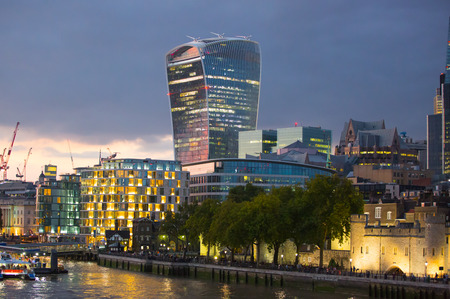 night dusk: LONDON, UK - SEPTEMBER 19, 2015: City of London at dusk and first night lights.  View includes Gherkin and other buildings at the background