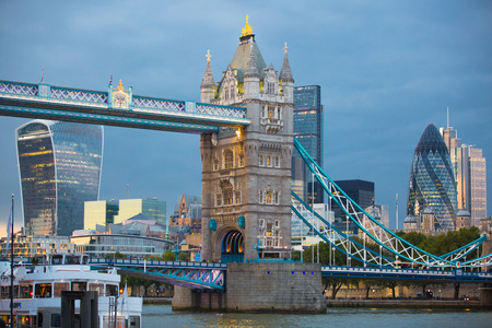 night dusk: LONDON, UK - SEPTEMBER 19, 2015: Tower bridge and City of London at dusk and first night lights.  View includes Walkie-Talkie  and other buildings at the background