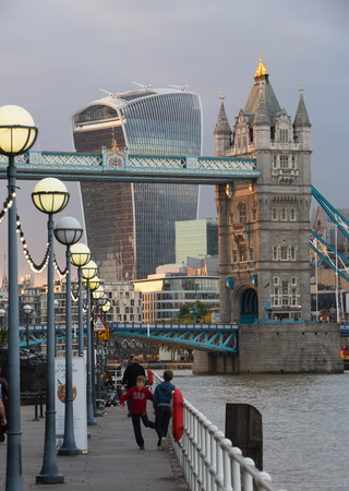 night dusk: LONDON, UK - SEPTEMBER 19, 2015: Tower bridge and City of London at dusk and first night lights.  View includes Walkie-Talkie building Editorial