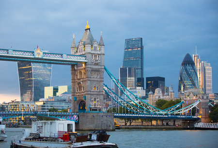 night dusk: LONDON, UK - SEPTEMBER 19, 2015: Tower bridge and City of London at dusk and first night lights.  View includes Gherkin and other buildings at the background
