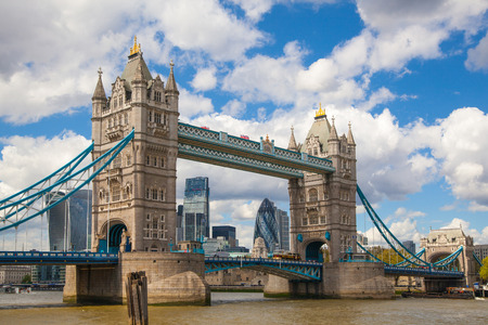 office buildings: LONDON, UK - SEPTEMBER 19, 2015: Tower bridge and City of London. View includes Gherkin and other buildings at the background