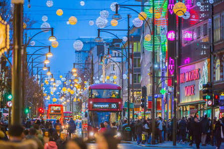 regent: LONDON, UK - DECEMBER 30, 2015: Christmas lights decoration at Regent street and lots of people walking during the Christmas sale and public transport, buses and taxies