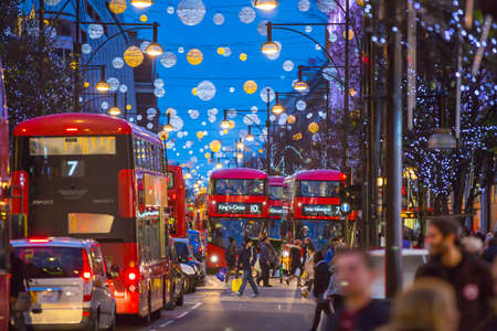 oxford street: LONDON, UK - DECEMBER 30, 2015: Christmas lights decoration at Oxford street and lots of people walking during the Christmas sale, public transport, buses and taxies