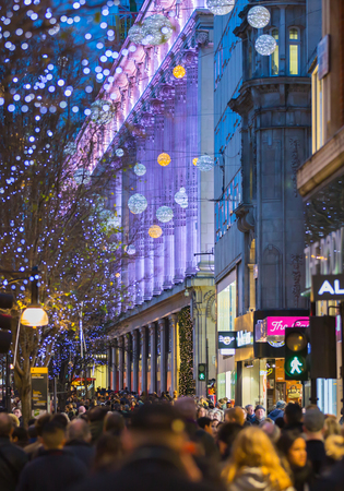 bargain hunting: LONDON, UK - DECEMBER 30, 2015: Selfridges department store. Christmas lights decoration at Oxford street and lots of people walking during the Christmas sale Editorial