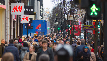 bargain hunting: LONDON, UK - DECEMBER 30, 2015: Christmas lights decoration at Oxford street and lots of people walking during the Christmas sale Editorial