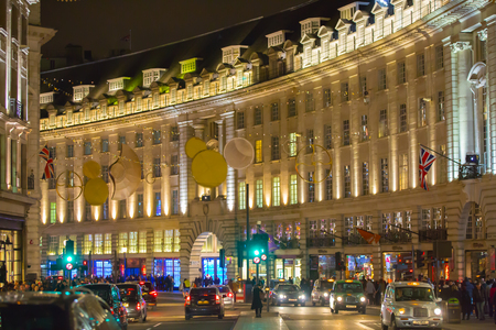 busses: LONDON, UK - DECEMBER 30, 2015: Oxford street view with Christmas lights decorating, lots of people shopping around and public transport, busses and taxies. Christmas rush, modern life concept