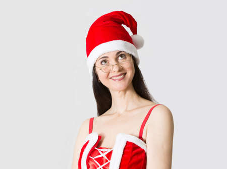 attractive woman: Attractive woman in Santa costume  looking up