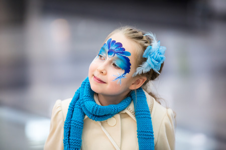 face of baby: Portrait of little girl with Christmas face painting