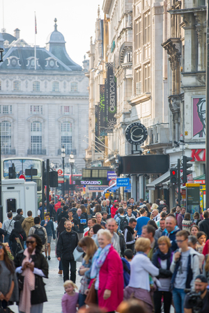 lots people: LONDON, UK - OCTOBER 4, 2015: Lots of people, tourists and Londoners walking via Leicester square, the famous destination of London for night life, cinemas, restaurants and bars