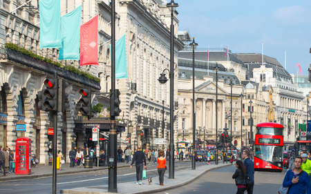 piccadilly: LONDON, UK - OCTOBER 4, 2015: Piccadilly street with lot of walking people, pedestrians and public transport, cars, taxis on the road. Editorial