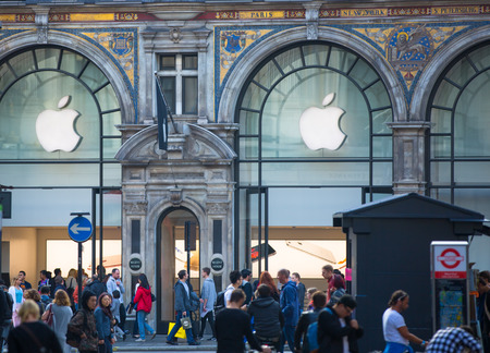 west end: LONDON, UK - OCTOBER 4, 2015: Apple store entrance at Regent street with lot of walking people, shopping at west end