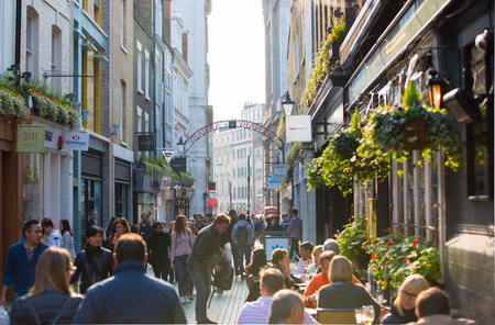 kingly: LONDON, UK - OCTOBER 4, 2015: Kingly street with cafes and restaurants and lots of walking people, tourists