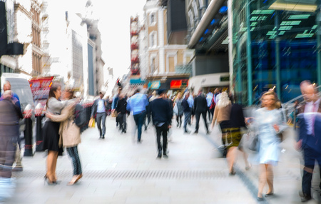 blurred people: LONDON, UK - MAY 17, 2016: Business people walk through the City of London street. Blurred image. City of London business life concept