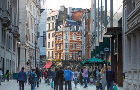 west end: LONDON, UK - OCTOBER 4, 2015: Regent street with lots of walking people crossing the road. Shopping at west end