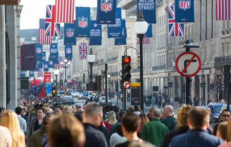 west end: LONDON, UK - OCTOBER 4, 2015: Regent street with lot of walking people, shopping at west end and public transport, taxis, cars and buses