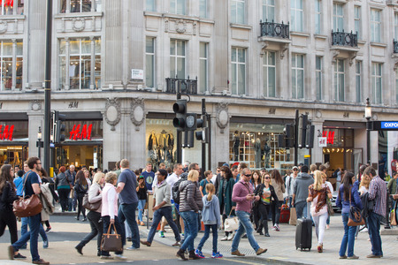 crossing street: LONDON, UK - OCTOBER 4, 2015: Regent street with lots of walking people crossing the road. Shopping at west end